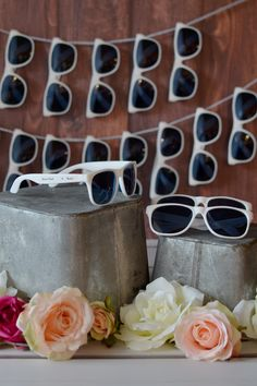 White frame sunglasses personalized with the bride and groom's name and wedding date make fun, useful, and affordable outdoor and destination wedding favors guests of all ages will love and appreciate. Set up a sunglasses station at your outdoor reception