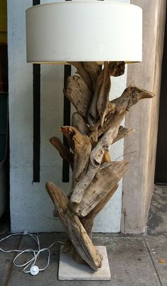 Driftwood lamp. I collect driftwood two blocks away on Venice Beach, so will undertake this project someday... ~ETS