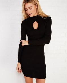 "<p>Want to make a subtle yet sultry statement? We've got your dress! This LBD is designed by Contempo Casuals™ and flaunts in all the right places. Features include a ribbed, sweater knit body, a mock neckline, and a keyhole opening at the front.</p>  <p>Model wears a size small.</p>  <ul> 	<li>Mock Neckline</li> 	<li>Long Sleeves</li> 	<li>Pull-on Construction</li> 	<li>Unlined</li> 	<li>33"" From Shoulder to Hem</li> 	<li>Rayon / Polyester</li> 	<li>Machine Wash</li> ..."
