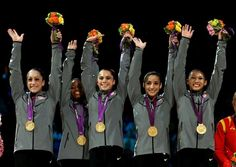 Jordyn Wieber, Gabrielle Douglas, McKayla Maroney, Alexandra Raisman and Kyla Ross of the United States celebrate on the podium after winning the gold medal in the Artistic Gymnastics Women's Team final on Day 4 of the London 2012 Olympic Games at North Greenwich Arena on July 31, 2012 in London, England.