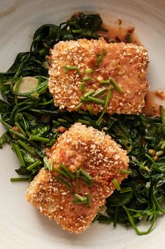 NYT Cooking: Coated in panko and sesame seeds, tofu takes on a splendid crunchiness that contrasts with sautéed spinach in this 30-minute dish. It comes together under a fragrant coconut-lime dressing — which you can double, then toss with salad. Swap out the spinach to your taste: Try this with mustard greens or chopped collard greens, adjusting the cooking time accordingly. Be careful when handling the un... Spinach Recipes, Tofu Recipes, Vegetarian Recipes, Cooking Recipes, Healthy Recipes, Cooking Time, Dinner Recipes, Sesame Tofu, Lime Dressing