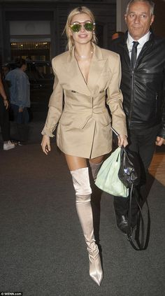 Legs for days: Hailey Baldwin proved she could turn any surface into a runway as she made a glamorous post-Missoni show appearance in Milan on Saturday