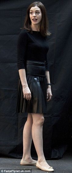 Different styles: Anne looked sexy in a leather skirt and matching black top while on set
