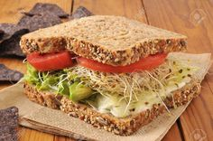 26360801-A-healthy-vegetable-sandwich-with-avocado-alfalfa-sprouts-tomatoes-and-lettuce-on-sprouted-nut-and-s-Stock-Photo.jpg (1300×863)
