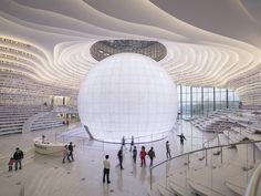 The Tianjin Binhai Library, a 33,700m2 cultural centre, features a luminous spherical auditorium around which floor-to-ceiling bookcases cascade. The undulating bookshelf is the building's main spa…