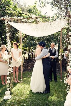 Outdoor ceremony with flowers. Love the strings of flowers hanging down.
