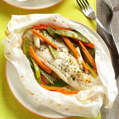 Fish & Vegetable Packets Recipe -This traditional cooking technique imparts flavor into every bite of your meal, and it requires very little clean-up. I like to serve fish still wrapped in parchment or foil for each person to open. —Jill Anderson, Sleepy Eye, Minnesota