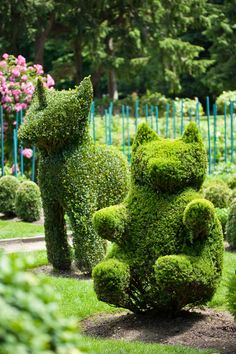 Garden with many topiary animals Topiary dog and bear