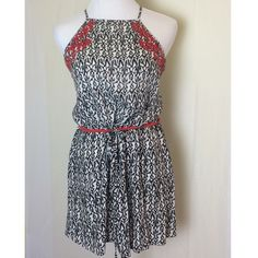 THML tunic tank Cute tunic top or mini dress by THML. Blank and white print with tomato red drawstring waist and embroidery. Has cross back adjustable straps. Excellent condition. THML Tops