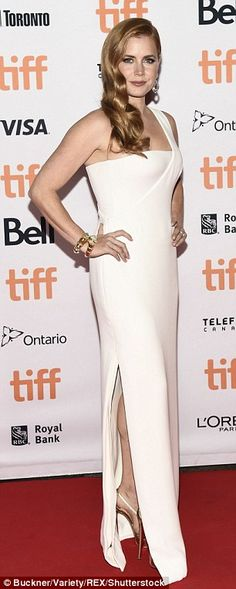 Amy Adams flashes cleavage in figure-hugging white dress at TIFF