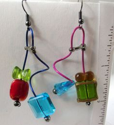 Carly, unmatched, mobiles, red, blue, green,purple, turquoise, geometric, contemporary, asymmetrical, fun, funky, guitar strings by Lindatwist on Etsy