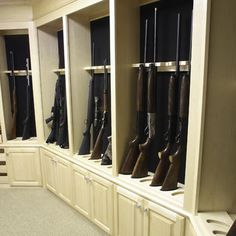 Gun room...he would so want a room like this in our house one day!