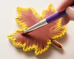 SweetAmbs: Brush Embroidery Tutorial - - To make SweetAmbs brush embroidered fall leaf cookies, use our Classic Sugar Cookies and Royal Icing recipes. This fall icing color palette consists of dark brown, auburn, orange, golden yellow. Acorn Cookies, Pumpkin Sugar Cookies, Halloween Sugar Cookies, Leaf Cookies, Soft Sugar Cookies, Fall Cookies, Iced Cookies, Sugar Cookie Recipe With Royal Icing, Cookie Icing