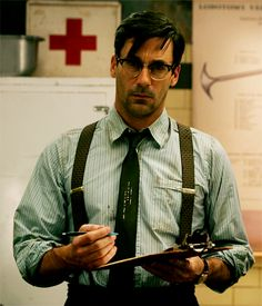 Jon Hamm | those glasses...those suspenders...that clip board! UNFFFFFFFFFFFFFF!!