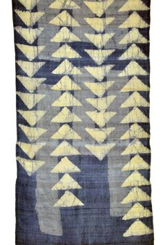 Finely hand woven silk is resist dyed with an allover triangle pattern and naturally-dyed with indigo creating a subtle and elegant scarf. $132.00 || ClothRoads