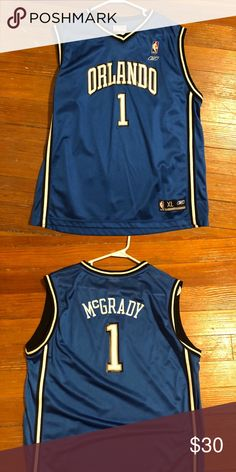 345830028e9ff Shop Men s NBA Blue White size XL Tank Tops at a discounted price at  Poshmark. Description  Orlando Magic Youth Tracy McGrady NBA Jersey Sold by  Fast ...
