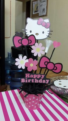 My DIY Hello Kitty Centerpiece. As an added touch I might make hello kitty cutouts to glue to the flatware set.