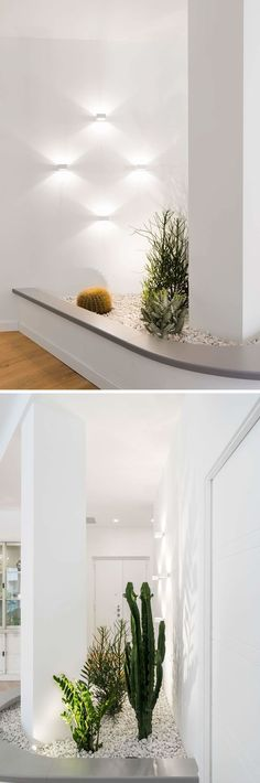 To work with an awkward column, the designers of this interior built a planter with a bench that incorporates the column, and draws the eye to the lighting and plants, helping the column to 'disappear' and blend into its surroundings. #Column #InteriorDesign #Planter #BuiltInPlanter