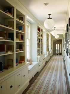 great idea on how to add bookcases to long expanses of wall.