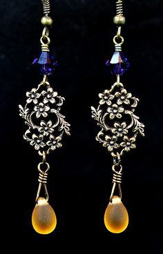 Antiqued brass earrings with amber & purple