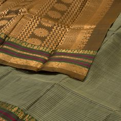 """The Striped """"#Grey"""" #handwoven #Kanjivaram #Silk #Sari from Ghanshyam Sarode is woven with gold zari floral motifs border on either side. Attractive floral motifs in gold zari adorn the brown pallu. The border is repeated on the brown blouse that completes the sari."""