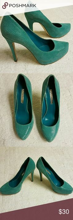 BCBGeneration high heals Turquoise snake-looking skin BCBGENERATION high heel. Wore twice for 2 hrs. each. Selling because I have bunions & have a hard time wearing heels. Make an offer.***SMOKE AND PET FREE HOME *** BCBGeneration Shoes Heels