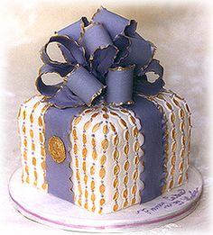 present with purple ribbon cake: Cake Design By Fancy Cakes