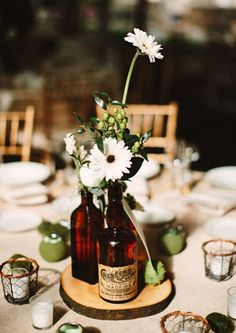 amber colored bottles in rustic centerpiece.