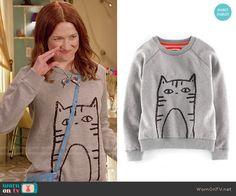 Kimmy's sequin cat sweatshirt on Unbreakable Kimmy Schmidt.  Outfit Details: https://wornontv.net/57376/ #UnbreakableKimmySchmidt