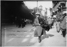 A young girl carrying bundle of coats home to be finished in Photo by Lewis Hine. New York To Paris, New York City, Carleton Watkins, Lewis Hine, Research Images, Places In America, Still Picture, Punk Princess, Photo Maps