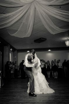 The couple's first dance sealed with a Hollywood kiss makes for one heck of a unique couple photo - Wedding Couple Photos, Wedding Couples, Hollywood Wedding, Wedding Kiss, First Dance, Unique Photo, Newlyweds, Real Weddings, Take That