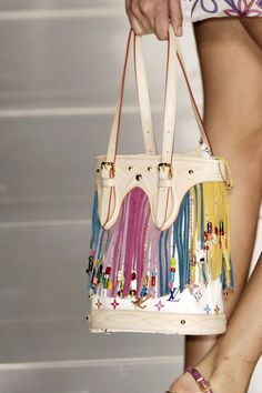 If you had a plain white bag with the colored fringe, that would be best. So sick of label's names and initials.