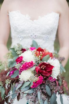 winter wedding bouquet, photo by Tom and Keidi Photography http://ruffledblog.com/leafy-winter-inspiration #flowers #red #winterwedding