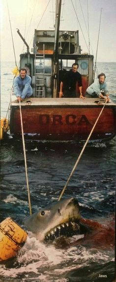 """Robert Shaw, Roy Scheider and Richard Dreyfuss aboard the Orca in """"Jaws"""" directed by Steven Spielberg. Jaws Film, Jaws Movie, I Movie, Shark Film, Jaws Boat, Jaws 2, Megalodon, Martin Scorsese, Steven Spielberg"""