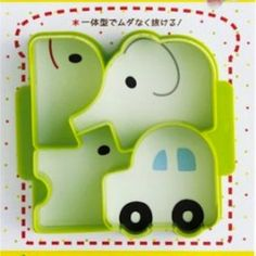 Japanese sandwich cutter with four shapes: a car, a dog, an elephant and a whale