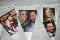 Photographs of the happy couple were digitally printed on to vinyl bunting as a lovely surprise for this bride and groom to be, perfect keepsake!