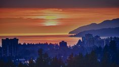North Vancouver sunset over Georgia Strait with the Point Atkinson Lighthouse in the distance. North Vancouver, Optical Illusions, Lighthouse, Distance, Georgia, Canada, Sunset, Bell Rock Lighthouse, Lighthouses