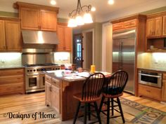 Transitional Kitchen Natural Cherry Wood Cabinets With A Black