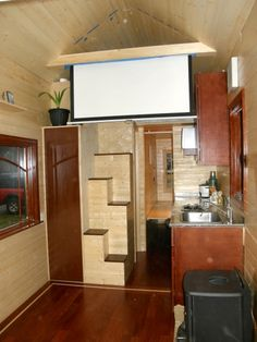 Tiny house stairs and pull down projector screen