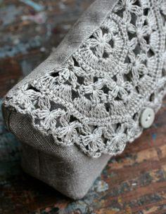 Linen clutch, pouch, purse, makeup bag -- crocheted detail closure. $36,00, via Etsy.