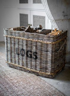 The Log Basket with Rope is a neat way to store logs by the fire