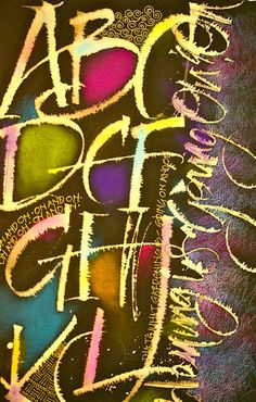 "Tina Cronkite in 2009  I used bleach with the Ruling Writer pen on black Arches for the alphabet for the first round. Then rubbed pastels in between the letters. I love the way the color pops! Then added the ""Zentangly"" marks with pen and also added colored pencil."
