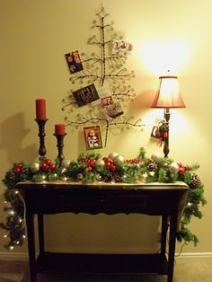 Christmas Vignette....love the garland draped over the table.