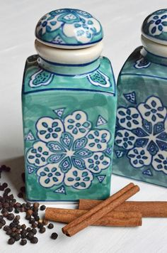 A fair trade family business in India crafts these lovely ceramic jars, hand-painting each one, giving them color and charm. Traditionally used to hold spices,