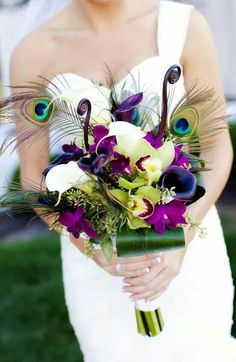 Peacock wedding bouquet for the bride! #Purples
