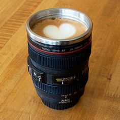 Take a mug shot. - Realistic 24 ~ 105mm DSLR camera lens cup, - Comes with a lens cap - Dishwasher safe. Warranty: - 1 year against manufacturing defects. -www.cooliyo.com