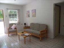 De woonkamer van een appartement met 2 slaapkamers. Happy Turtle Apartments Curacao Happy Turtle, Couch, Furniture, Home Decor, Settee, Decoration Home, Sofa, Room Decor, Home Furnishings