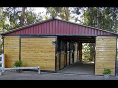 3- Stall Shedrow Barn  shown with:  - 3:12 roof pitch  - 12' overhang  - 8' eaves  - brown frame  - grilled stall fronts  - enclosed overhang   - solid sliding doors  - Grand Prix metal Ultra Cool roofing and filler panels