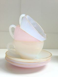 Beautiful pastel coloured tea cups and saucers.