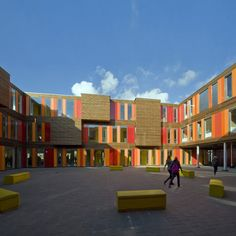 Dutch practice HVDN architecten have completed this wood and aluminium-clad building to temporarily house a school in Amsterdam, the Netherlands. Called Het Gymnasium, the modular building has a. School Building Design, School Design, Education Architecture, Facade Architecture, Wooden Facade, Internal Courtyard, Gymnasium, School Photography, Building Facade